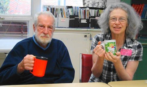 Gilbert and Becky CHEER to warm cups of coffee!
